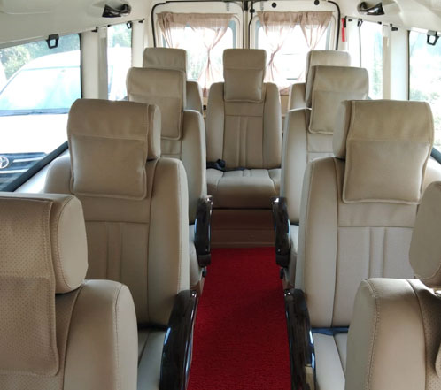 9 seater deluxe 1x1 tempo traveller hire in gurgaon